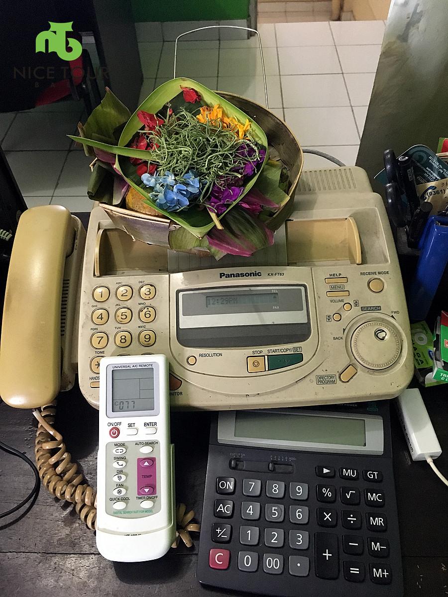 We worship fax machine in office during Tumpek Landep Festival Bali.